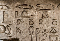 Hieroglyphs. Well preserved authentic real Egyptian hieroglyphs on the wall in the Sobek temple in Kom Ombo, Egypt (woman, key of life, arm, leg Royalty Free Stock Photos