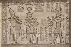 Hieroglypic carvings on an egyptian temple. Hieroglyphic carvings on the exterior walls of an ancient egyptian temple Royalty Free Stock Photography