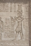 Hieroglypic carvings on an egyptian temple. Hieroglyphic carvings on the exterior walls of an ancient egyptian temple Royalty Free Stock Images