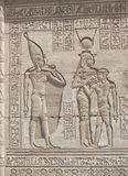 Hieroglypic carvings on an egyptian temple. Hieroglyphic carvings on the exterior walls of an ancient egyptian temple Stock Photos