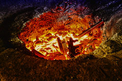Hierro de fusión en un horno Fotos de archivo libres de regalías