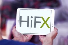 HiFX foreign exchange broker logo. Logo of HiFX company on samsung tablet. HiFX is foreign exchange broker and payments provider. The company provides foreign royalty free stock image