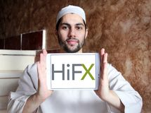 HiFX foreign exchange broker logo. Logo of HiFX company on samsung tablet holded by arab muslim man. HiFX is foreign exchange broker and payments provider. The stock images