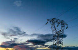 Hig voltage at sunset Stock Image