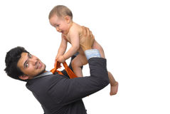 High. Young man holding a baby high, against a white background Royalty Free Stock Photography