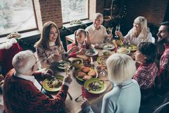 High above angle view of noel diverse family gathering. Cheerful stock photo