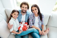 High above angle view portrait of nice cute lovely attractive cheerful cheery positive people mom dad sitting on divan royalty free stock image