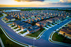 High Above Austin Texas Suburb suburbia homes and houses thousands at amazing Sunset. Aerial drone view high above streets and modern architecture new royalty free stock photo