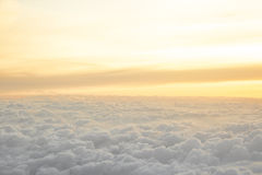 High above the clouds with beautiful sunset light. Stock Photography