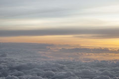 High above the clouds with beautiful sunset light. Stock Photos
