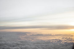 High above the clouds with beautiful sunset light. Royalty Free Stock Photography