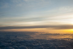 High above the clouds with beautiful sunset light. Royalty Free Stock Photo