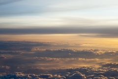 High above the clouds with beautiful sunset light. Royalty Free Stock Image