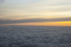 High above the clouds with beautiful sunset light. Royalty Free Stock Images