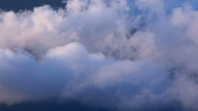 High above clouds panning with top of mountains stock video footage