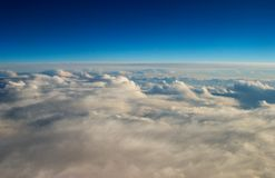 High above the earth. A glourious view of clouds from 30,000 feet in the air Stock Image