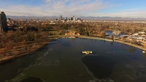 City Park Lake Denver Colorado Skyline Migrating Geese Birds Wildlife. High above Lake Ferril in Denver looking at some Geese who have stopped over for a rest stock video footage