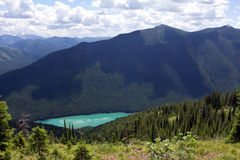 High Above The Wilderness Lake. This image of the beautiful turquoise lake was taken from Stanton Ridge in the Great Bear Wilderness of Montana Stock Photo