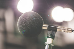 High accuracy microphone in noise sound testing room with LED light bokeh. High technology. Microphone for noise recorder. Selective focus stock photography