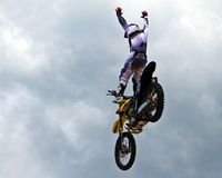 High achievement. Motorbike stunt riders entertain the public with high flying acrobatics at the annual Republic of Texas biker rally, held every year the week Royalty Free Stock Photo