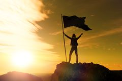High achievement, silhouettes of the girl, flag of victory royalty free stock photo