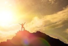 High achievement, the silhouettes of the girl, on the top of the mountain, stock image