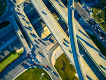 High Aerial Drone view over overpassing interchanges and interstates and highways and roads Stock Photo