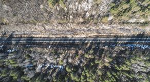 High aerial drone view of an railroad across the spring forest. Rural places stock photos