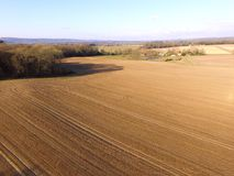Aerial still image of crop fields in the rural County of Sussex, England. Royalty Free Stock Photography
