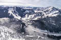 Helicopter View of Winter Sports Resort in Pacific Northwest Mountains royalty free stock photos