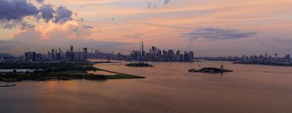 High Aerial View New York Panoramic Jersey City Brooklyn Statue of Liberty. Three major cities can be seen in this dramatic aerial view from Bayonne New Jersey stock image