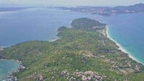 Aerial view bay peninsula with small village against sea stock video footage