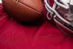 High agnle view of American football and helmet on jersey Royalty Free Stock Image