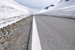 High Alpine Road, Timmelsjoch, Austria. Route connecting northern Europe (Austria) and southern Europe (Italy). Image shows a small asphalt street with some Royalty Free Stock Photo