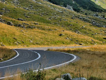 Close Up High alpine winding road view Stock Photo