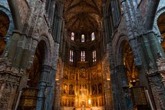 High altar of the gothic Cathedral of Avila. Inside view of the retable and High Altar of the Cathedral in Avila, a Romanesque and Gothic church in the South of Stock Photos
