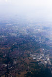 A high altitude aerial shot of landscape with fields, forests and cities Stock Images