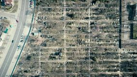 High altitude aerial shot of old catholic cemetery on a sunny spring day, top view Royalty Free Stock Photo