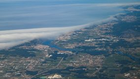 High altitude Aerial shot from plane over Braga district in Portugal. Showing cities of Esposende, Apulia and Fao and the Cavado river stock photos