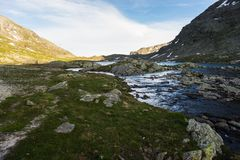 High altitude alpine lake and stream at sunset Stock Photo