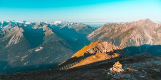 High altitude alpine landscape, sunrise light on the majestic high peaks and glaciers, Aosta Valley, Italy. Teal orange look. High altitude alpine landscape royalty free stock images