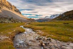 High altitude alpine stream in autumn season Stock Photos