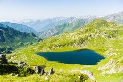 High altitude blue alpine lake in summertime Stock Photo