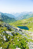 High altitude blue alpine lake in summertime Stock Images