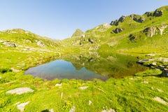 High altitude blue alpine lake in summertime Stock Image