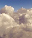 High altitude cumulus clouds. Cumulus clouds shot from a high altitude against a blue sky royalty free stock image