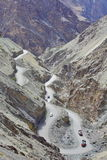 High-altitude curvy road in the Himalayas Royalty Free Stock Photos