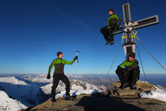High altitude delusion. Three identical man on a mountain summit Stock Photography