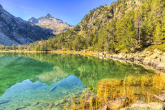 High Altitude Lake. Beautiful high altitude lake les Laquettes located in Pyrenees Mountains, in Neouvielle Massif Stock Image