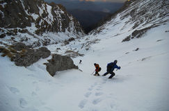 High Altitude Mountain Climbers. Climber descending from the mountains in the morning . Bucegi - Romania in background lowest part of Morarului Valley and Stock Photography